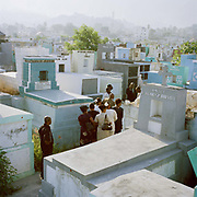 Mourners at the main cemetery, Port Au Prince. On Tuesday 12th of January at 16.53pm local time the biggest Earthquake to hit Haiti for 200 years struck with devastating force. 230,000 people were killed, 300,000 injured and 1.2 million left needing emergency shelter. Survivors have lost family, homes, livelihoods and essential services. Hospitals, schools and government buildings were also destroyed'. These pictures are of the survivors three weeks later.