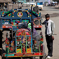 Asia, India, Rajasthan. A contraption consists of an tractor engine converted to use as a transport vehicle in Rajasthan.