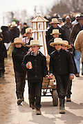 Amish boys pull a wagon during the Annual Mud Sale to support the Fire Department  in Gordonville, PA.
