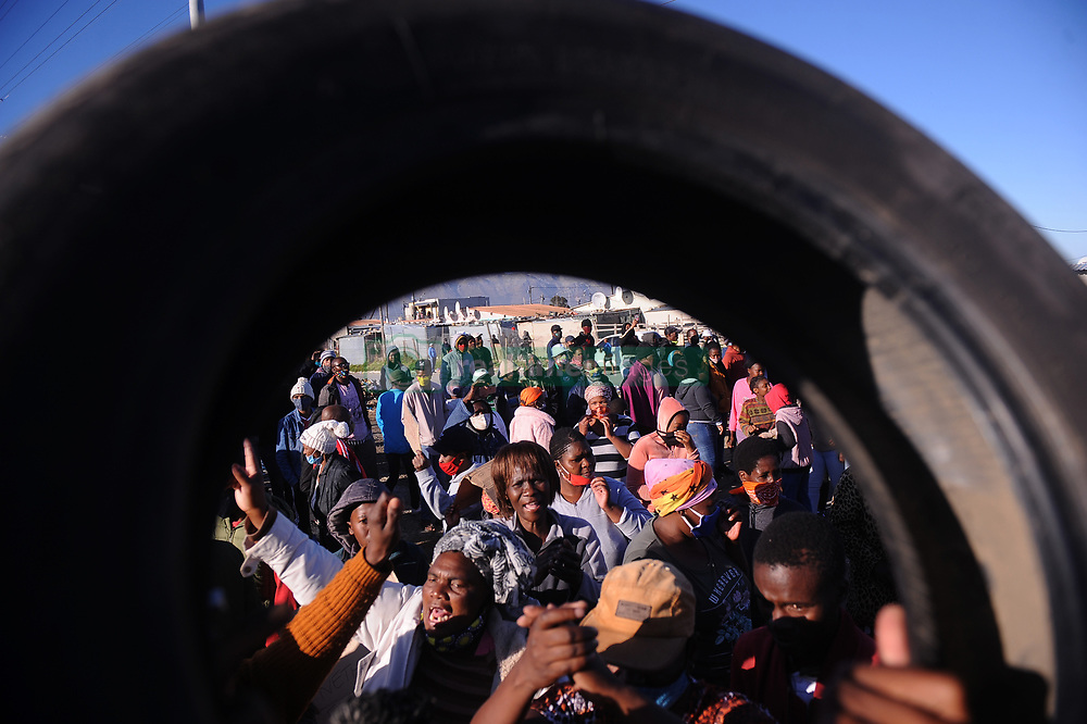 South Africa - Cape Town - 31 July 2020 - Strand Community protest for service delivery like potholes on the roads blocked drains and dirty streets, a planned total shutdown in Lwandle   Photographer Ayanda Ndamane African News Agency(ANA)