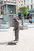 Street cleaner statue, Plaza Jacinto Benavente, Madrid, Spain