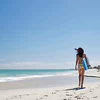 Girl with boogie board at Leighton Beach