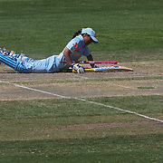 Indian batter Amita Sharma is run out from a throw by Sophie Devine as Wicket keeper Rachel Priest celebrates during the match between New Zealand and India in the Super 6 stage of the ICC Women's World Cup Cricket tournament at North Sydney  Oval, Sydney, Australia on March 17, 2009. Photo Tim Clayton