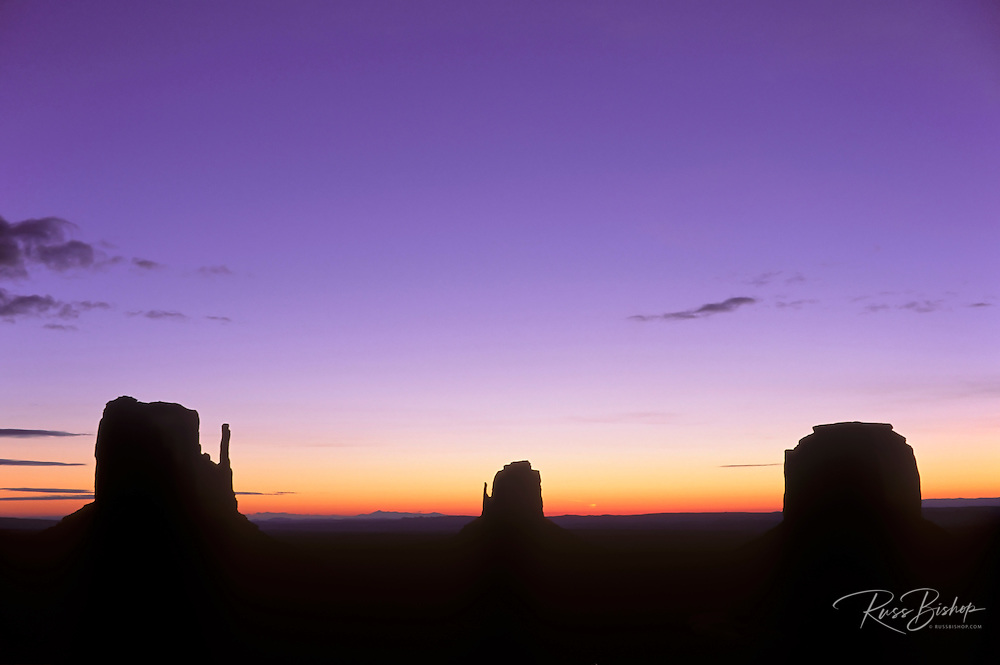 Mitten Buttes silhouetted against dawn sky, Monument Valley Navajo Tribal Park, Arizona