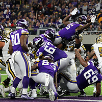 MINNEAPOLIS, MN - OCTOBER 28: Latavius Murray #25 of the Minnesota Vikings leaps with the ball for a touchdown  in the second quarter of the game against the New Orleans Saints at U.S. Bank Stadium on October 28, 2018 in Minneapolis, Minnesota. (Photo by Adam Bettcher/Getty Images) *** Local Caption *** Latavius Murray