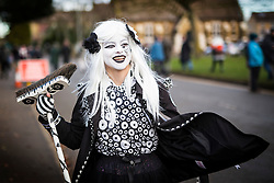 DATE CORRECTION. IMAGES SHOT 14/01/2017 © Licensed to London News Pictures. 14/01/2017. Whittlesey UK. Picture shows a member of the Pig Dyke Molly dancers at the 38th Whittlesey Straw Bear Festival this weekend. In times past when starvation bit deep the ploughmen of the area where drawn to towns like Whittlesey, They knocked on doors begging for food & disguised their shame by blackening their faces with soot. In Whittlesey it was the custom on the Tuesday following Plough Monday to dress one of the confraternity of the plough in straw and call him a Straw Bear. The bear was then taken around town to entertain the folk who on the previous day had subscribed to the rustics, a spread of beer, tobacco & beef. The bear was made to dance in front of houses & gifts of money, beer & food was expected. Photo credit: Andrew McCaren/LNP