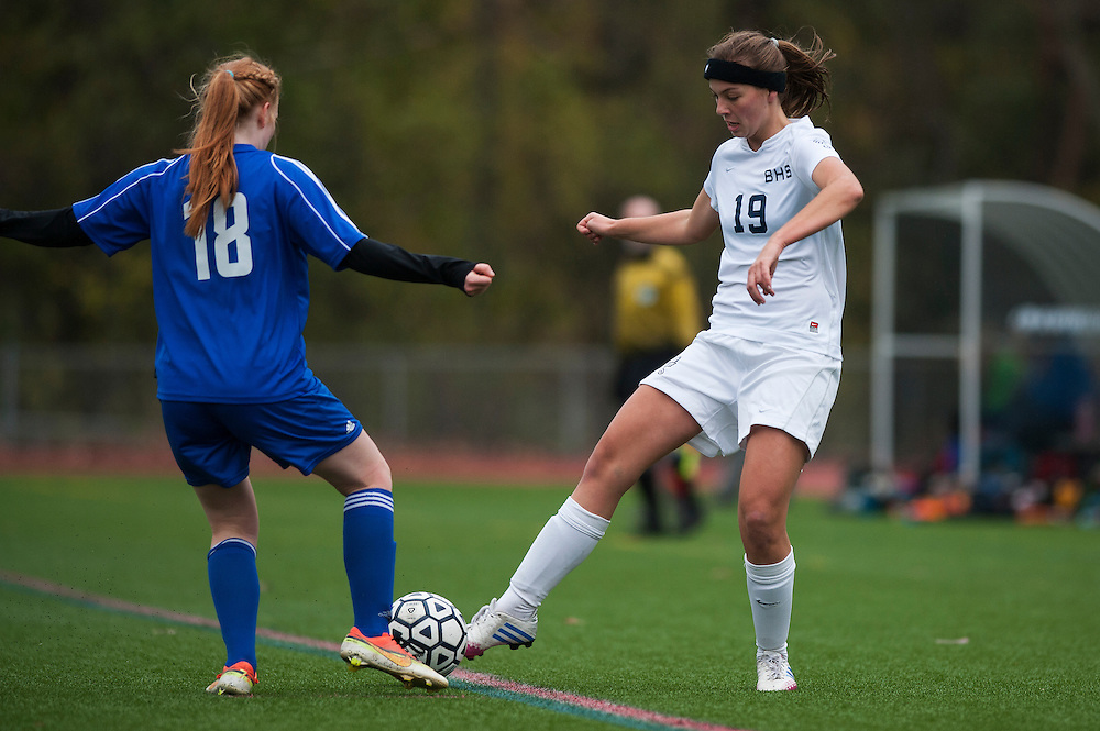 Burlington's Casey O'Neill (19) and U-32's Nell Peterson (18) battle for the ball during the girls playoff soccer game between the U-32 Raiders and the Burlington Sea Horses at Buck Hard Field on Friday afternoon October 24, 2014 in Burlington, Vermont (BRIAN JENKINS, for the Free Press)