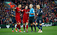Football - 2018 / 2019 Premier League - Liverpool vs. Manchester City<br /> <br /> Dejan Lovren of Liverpool and Andy Robertson of Liverpool complain to the referee after he gives a penalty after Leroy Sane of Manchester City is fouled for a penalty by Virgil van Dijk of Liverpool at Anfield.<br /> <br /> COLORSPORT/LYNNE CAMERON