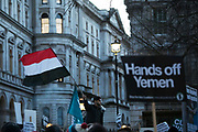 Protesters agains the visit by Saudi prince Bin Salman gather opposite Downing Street March 7th 2018 in London, United Kingdom. A young man waving the flag of Yemen. Many are angry at the Saudi involvement and continued bombing in Yemen with tens of thousands of civilian casualties and many more displaced by the war. (photo by Kristian Buus/In Pictures via Getty Images)
