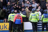 Fotball<br /> Championship England 2004/05<br /> Millwall v Leeds<br /> 6. mars 2005<br /> Foto: Digitalsport<br /> NORWAY ONLY<br /> Millwall fans taunt the police after Leeds' Rob Hulse socres the equaliser