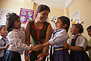 Young Nepalese children play a game during a relationship building session facilitated by a staff member called Sandi in the Voice of Children centre in Kankeshori area of Kathmandu, Nepal.  The not-for-profit organisation supports street children and those who are at risk of sexual abuse through educational and vocational training opportunities, health services and psychosocial counseling.  These young children have recently been found by the charity and attend the children's drop-in centre where they play games and activities.