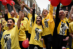 "© Licensed to London News Pictures. 05/09/2018. LONDON, UK. Fundraising volunteers prepare to join fans of Freddie Mercury and members of the public in Carnaby Street donning moustaches during ""Freddie for a Day"", a fundraising event in aid of the Mercury Phoenix Trust on Freddie Mercury's birthday.  Queen tribute band ""Bulsara and the Queenies"" sang iconic songs entertaining crowds.  Photo credit: Stephen Chung/LNP"