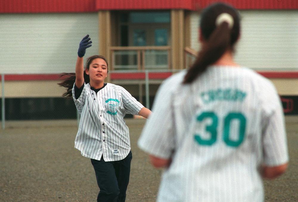 Alaska, Barrow. Women's softball game. Cindy Nusunginya.