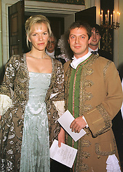 MISS ELISABETH MURDOCH, daughter of Media tycoon Rupert Murdoch and MR MATTHEW FREUD,  at a party in London on 7th December 1998.MMT 23