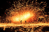 Artists perform Stunning iron fireworks