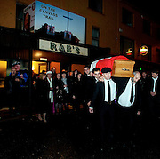 7-12-2014: Led by traditional pikemen carrying lighted turf the remains of former South Kerry TD, Jackie Healy-Rae are carried by his sons and grandsons during the removal from his pub to local church at 10pm in Kilgarvan in County Kerry on Sunday.<br /> Picture by Don MacMonagle <br /> <br /> <br /> <br /> Photo: Don MacMonagle <br /> e: info@macmonagle.com