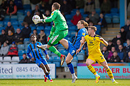 Oxford United goalkeeper Simon Eastwood (1) and Gillingham FC forward Tom Eaves (9) in early action during the EFL Sky Bet League 1 match between Gillingham and Oxford United at the MEMS Priestfield Stadium, Gillingham, England on 9 March 2019.