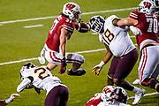 Wisconsin running back Garrett Groshek (37) runs over Minnesota defensive back Tyler Nubin (27) during overtime of an NCAA college football game Dec. 19th. Wisconsin beat Minnesota 20-17 in overtime. (AP Photo/Andy Manis)