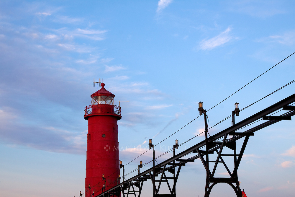 Grand Haven Inner Lighthouse was constructed in 1905.  It is constructed of steel plates.  It marks the entrance the Grand River in Grand Haven Michigan.  It stands 51ft tall.