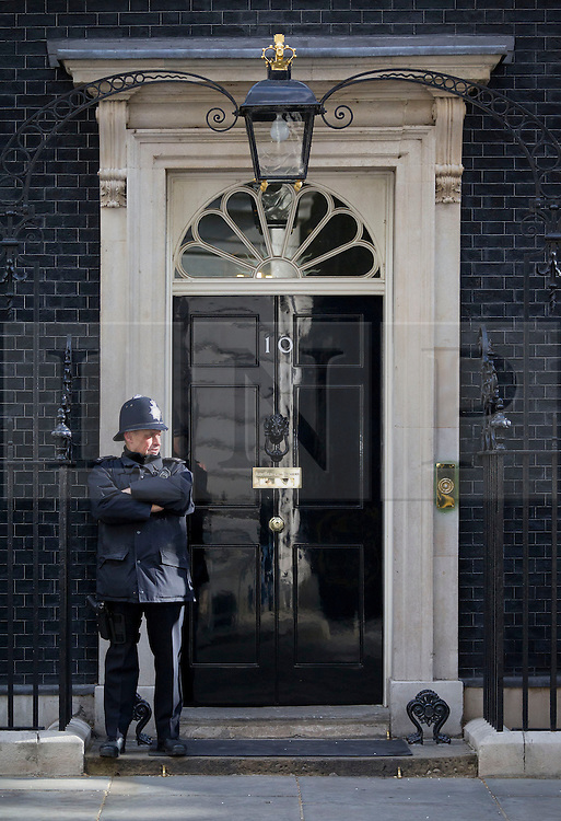 © Licensed to London News Pictures. 23/05/2013. London, UK. The a policeman guards Number 10 Downing Street, the residence of the British Prime Minister David Cameron, in London today (23/05/2013) as an emergency meeting of COBRA (Cabinet Office Briefing Room A) takes place to discuss yesterday's alleged terrorist attack in Woolwich. Photo credit: Matt Cetti-Roberts/LNP