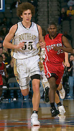 2/11/06 -- Omaha, Ne.Lincoln Southeast's Matt Hill running down the court in front of San Diego Hoover's Randy Mitchell The Omaha Shootout, a High School Basketball tournament featuring some of the best prospects at the Qwest Center Omaha...(Photo by Chris Machian/Prarie Pixel Group).