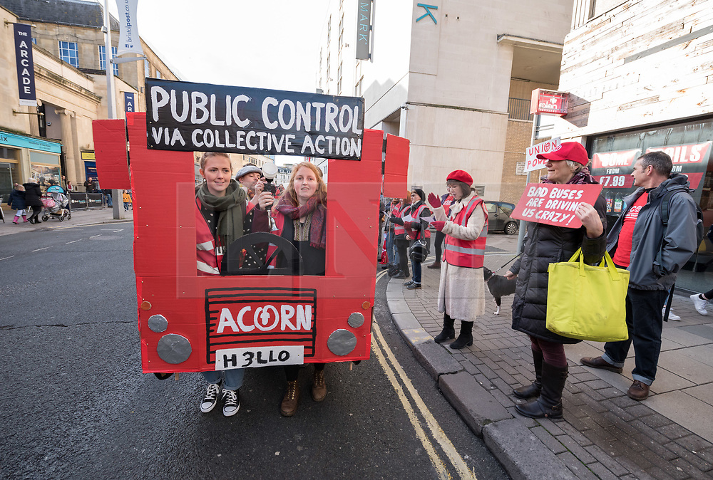 © Licensed to London News Pictures. 18/01/2020. Bristol, UK. Protest through Broadmead shopping centre for the public launch of the Take Back Our Buses campaign. The event was organised by the ACORN Union and featured Bristol's biggest ever bus queue and their own human-powered bus. ACORN is campaigning for Bristol buses to be taken into public control by calling on the Mayor of West of England to a consultation for a franchising model. ACORN say this would allow Bristol to regain control on extortionate ticket prices, chronically late services and shrinking bus routes across the city and that if the public control the buses, they could work for the public, not First Bus shareholders. They say outside London, passenger numbers have fallen by half, whilst average prices have risen 35% above inflation since the 1980s, but bus companies' shareholders have made £billions from fares and subsidies. The campaign is calling on Tim Bowles and Marvin Rees (West of England & Bristol Mayors) and Bristol, Bath & North East Somerset and South Gloucestershire Councils to support a worker-led buyout of First Bus, with the Councils each taking a stake to bring buses back into partial public ownership; launch an investigation and consultation as a first step to introducing a franchising so we can control the routes, fares and timetables of our bus services; manage contracts carefully under any franchising arrangement to guarantee workers' conditions and good levels of service for the most deprived areas in the region. ACORN (The Association of Community Organisations for Reform Now) is a union organising working class communities across the UK, and has branches across the country, including Bristol, Sheffield, Newcastle, Manchester and Brighton. Photo credit: Simon Chapman/LNP.