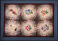 Quilt by Stephen Hoffman's mother, reproduction made in the studio.