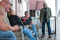 Lisa Tivnan and Stu Wiley at the rental house in the Weir's during Laconia Motorcycle Week. NH, USA. June 21, 2014.  Photography ©2014 Michael Lichter.