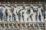 Scene from The Last Judgment on the Romanesque facade of Ferrara Cathedral. <br /> <br /> Ferrara Cathedral (Basilica Cattedrale di San Giorgio, Duomo di Ferrara) is a Roman Catholic cathedral and minor basilica in Ferrara, Northern Italy. The original Romanesque design of Ferrara Cathedral is manifest in the façade. In the centre of the façade of Ferrara Cathedral is a porch, supported by two columns with Atlases seated on lions at the bases. It is decorated with a Last Judgement by an unknown master and a loggia with a Madonna and Child (a late Gothic addition). The portal of Ferrara Cathedral is the work of the sculptor Nicholaus, a pupil of Wiligelmus. The lunette shows Saint George, patron saint of Ferrara, slaying the dragon; scenes from the Life of Christ appear on the lintel. The jambs framing the entrance of Ferrara Cathedral are embellished with figures depicting the Annunciation and the four prophets who foretold the coming of Christ.<br /> <br /> Visit our ITALY PHOTO COLLECTION for more   photos of Italy to download or buy as prints https://funkystock.photoshelter.com/gallery-collection/2b-Pictures-Images-of-Italy-Photos-of-Italian-Historic-Landmark-Sites/C0000qxA2zGFjd_k<br /> <br /> If you prefer to buy from our ALAMY PHOTO LIBRARY  Collection visit : https://www.alamy.com/portfolio/paul-williams-funkystock/ferrara.html .