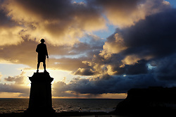 (C) Licensed to London News Pictures. 23/04/2016<br /> Whitby, UK<br /> <br /> A seagull sits on the head of the Captain Cook monument as early morning sun shines down on the North Yorkshire coastal town of Whitby. <br /> <br /> Photo Credit: Ian Forsyth/LNP