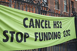 A Stop HS2 banner is pictured in Paternoster Square following an Extinction Rebellion Blood Money March through the City of London on 27th August 2021 in London, United Kingdom. Extinction Rebellion were intending to highlight financial institutions funding fossil fuel projects, especially in the Global South, as well as law firms and institutions which facilitate them, whilst calling on the UK government to cease all new fossil fuel investment with immediate effect.