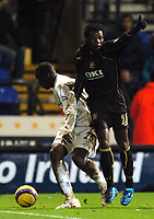 Photo: Paul Greenwood.<br />Bolton Wanderers v Portsmouth. The Barclays Premiership. 30/12/2006. Pompey's Benjani Mwaruwar, right appeals for a throw even though the ball is in  play.