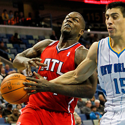 January 29, 2012; New Orleans, LA, USA; New Orleans Hornets power forward Gustavo Ayon (15) knocks the ball away from Atlanta Hawks forward Ivan Johnson (44) during the second half of a game at the New Orleans Arena. The Hawks defeated the Hornets 94-72.  Mandatory Credit: Derick E. Hingle-US PRESSWIRE