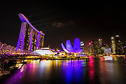 The ArtScience Museum, Marina Bay Sands, and downtown skyline from the Helix Bridge at night, Singapore, Republic of Singapore