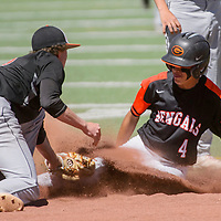 Gallup Bengal Joel Lopez (4) is tagged by Aztec Tiger Zack Taylor (3) as he slides into second base Saturday at Ford Canyon Park in Gallup.