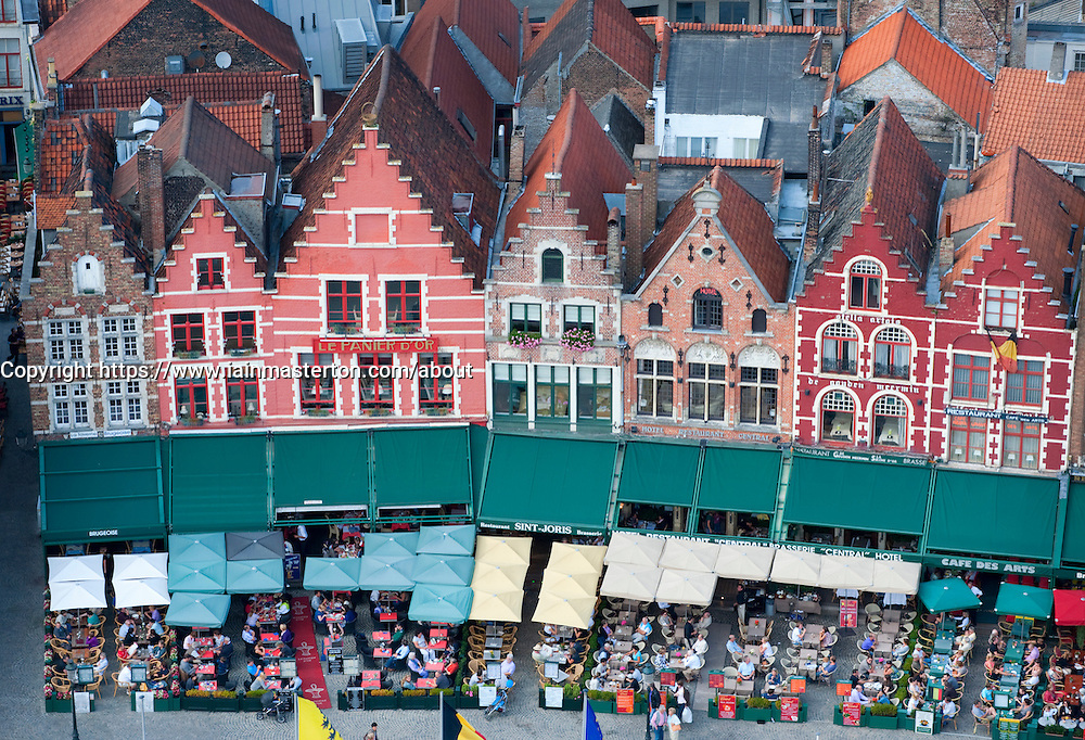 Row of ornate historic old houses in Market Square in  Bruges Belgium
