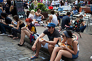 Having some lunch at Brick Lane for the Sunday Market. Many people come to sell their cast-off clothes and belongings to raise some cash. Official stalls selling clothers, food and all manner of crafts and junk make up the mainstay of the market though. These unofficial sellers though give the market it's unique atmosphere. This market is a weekly event in London's East End.