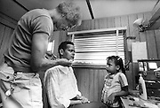 "Civil rights leader, politician, actor and former Chairman of the NAACP, Julian Bond, has died at age 75. Bond - left - sits in the makeup trailer during the filming of the 1977 feature film, ""Greased Lightning"". Bond's daughter watches the makeup process intently. The film starred Grier, Richard Pryor and Beau Bridges and chronicled the life of the first African American NASCAR driver - Wendell Scott."