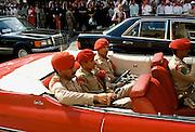 Armed guards in American Chevrolet Caprice Classic drop-head automobile in Riyadh, Saudi Arabia
