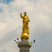 The Virgin Mary statue at the entrance to the port of Messina at Messina Sicily, Italy,