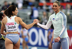 Slovenian triple  jump athletes Marija Sestak and Snezana Rodic in the Qualification when they qualified for finals at the 1st day of  European Athletics Indoor Championships Torino 2009 (6th - 8th March), at Oval Lingotto Stadium,  Torino, Italy, on March 6, 2009. (Photo by Vid Ponikvar / Sportida)