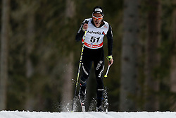 13.12.2014, Davos, SUI, FIS Langlauf Weltcup, Davos, 15 km, Herren, im Bild Jason Rueesch (SUI) // during Cross Country, 15km, men at FIS Nordic world cup in Davos, Switzerland on 2014/12/13. EXPA Pictures © 2014, PhotoCredit: EXPA/ Freshfocus/ Christian Pfander<br /> <br /> *****ATTENTION - for AUT, SLO, CRO, SRB, BIH, MAZ only*****