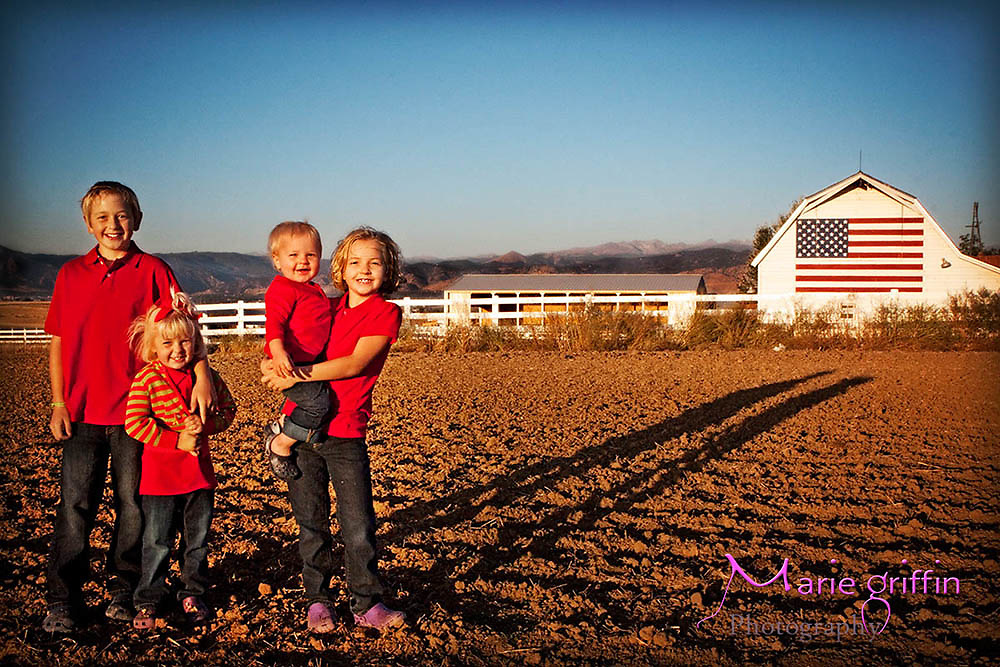 Detorie kids at a flag barn in Boulder County on Oct. 2, 2010. Xander(10), Abby(8), Sophie(4) and Charlie(18 months)<br /> Photography By: Marie Griffin Dennis<br /> mariefgriffin@gmail.com<br /> www.mariegriffinphotography.com