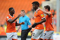 Blackpool's Armand Gnanduillet celebrates his side's first goal, an own goal by Peterborough United's Niall Mason (not in picture) with team-mates Sullay Kaikai and Matty Virtue<br /> <br /> Photographer Kevin Barnes/CameraSport<br /> <br /> The EFL Sky Bet Championship - Blackpool v Peterborough United - Saturday 2nd November 2019 - Bloomfield Road - Blackpool<br /> <br /> World Copyright © 2019 CameraSport. All rights reserved. 43 Linden Ave. Countesthorpe. Leicester. England. LE8 5PG - Tel: +44 (0) 116 277 4147 - admin@camerasport.com - www.camerasport.com