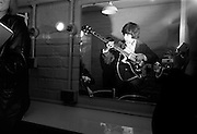 The Rolling Stones Charlie is my Darling - Ireland 1965...Bill Wyman of The Rolling Stones practices a bass line before appearing onstage at the Adelphi Theatre, Middle Abbey Street, Dublin. This was the band's second Irish tour of 1965....03/09/1965..09/03/1965..03 September 1965...The Rolling Stones Charlie is my Darling - Ireland 1965.Out November 2nd from ABKCO.Super Deluxe Box Set/Blu-ray and DVD Details Revealed. ..ABKCO Films is proud to join in the celebration of the Rolling Stones 50th Anniversary by announcing exclusive details of the release of the legendary, but never before officially released film, The Rolling Stones Charlie is my Darling - Ireland 1965.  The film marked the cinematic debut of the band, and will be released in Super Deluxe Box Set, Blu-ray and DVD configurations on November 2nd (5th in UK & 6th in North America).. .The Rolling Stones Charlie is my Darling - Ireland 1965 was shot on a quick weekend tour of Ireland just weeks after ?(I Can't Get No) Satisfaction? hit # 1 on the charts and became the international anthem for an entire generation.  Charlie is my Darling is an intimate, behind-the-scenes diary of life on the road with the young Rolling Stones featuring the first professionally filmed concert performances of the band's long and storied touring career, documenting the early frenzy of their fans and the riots their live performances incited.. .Charlie is my Darling showcases dramatic concert footage - including electrifying performances of ?The Last Time,? ?Time Is On My Side? and the first ever concert performance of the Stones counterculture classic, ?(I Can't Get No) Satisfaction.?  Candid, off-the-cuff interviews are juxtaposed with revealing, comical scenes of the band goofing around with each other. It's also an insider's glimpse into the band's developing musical style by blending blues, R&B and rock-n-roll riffs, and the film captures the spark about to combust into The Greatest Rock and Roll Band in the World.. .The 1