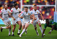 Rugby Union - 2020 / 2021 Gallagher Premiership - Round 19 - London Irish vs Exeter Chiefs - Brentford Community Stadium<br /> <br /> Exeter Chiefs' Joe Simmonds evades the tackle of London Irish's Lovejoy Chawatama to score his sides 2nd try.<br /> <br /> COLORSPORT