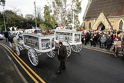 """© Licensed to London News Pictures. 14/02/2020. Sevenoaks, UK. Mourners watch as the coffins leave St John the Baptist church in Sevenoaks, Kent following the funeral service of traveller brothers Billy and Joe Smith. The twin brothers, who were made famous by the television programme """"My Big Fat Gypsy Wedding"""", were found hanged in woodland three days after Christmas. Photo credit: Ben Cawthra/LNP"""