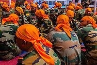 Indian Army soldiers visiting the Gurdwara Pathar Sahib, the Gurdwara was built in 1517 to commemorate the visit to the Ladakh region of Guru Nanak Dev, the founder Guru of the Sikh faith. Ladakh, Jammu and Kashmir State, India.