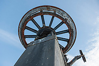 "One of the old cog wheels from a ski lift  ""back then"" at the Highlands Mountain Bike Park.  (Karen Bobotas/for the Laconia Daily Sun)"
