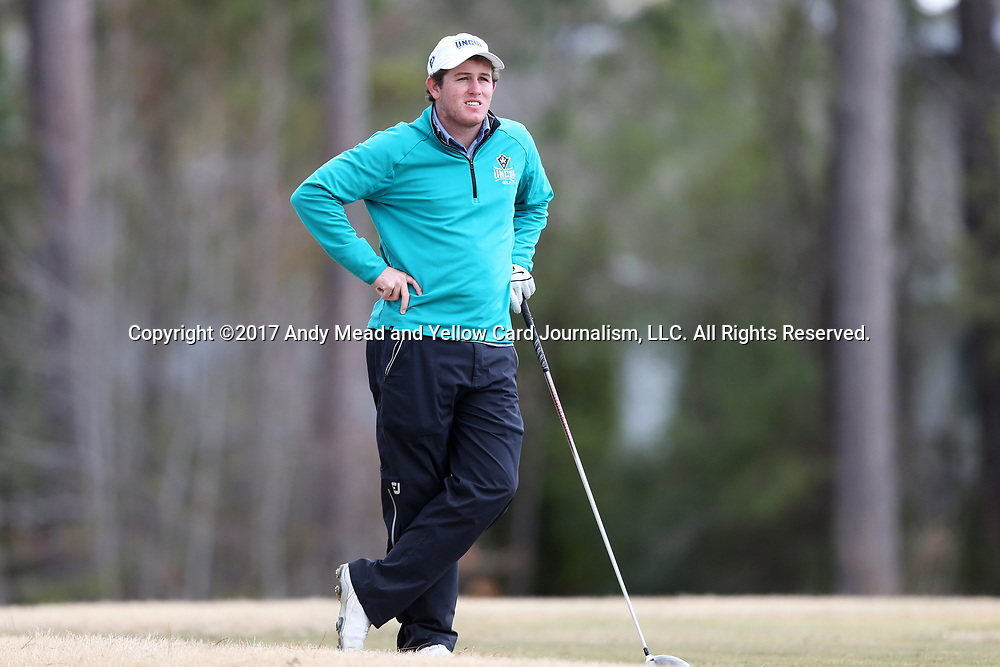 WILMINGTON, NC - MARCH 19: UNC Wilmington's Patrick Cover tees off on the Ocean Course ninth hole. The first round of the 2017 Seahawk Intercollegiate Men's Golf Tournament was held on March 19, 2017, at the Country Club of Landover Nicklaus Course in Wilmington, NC.